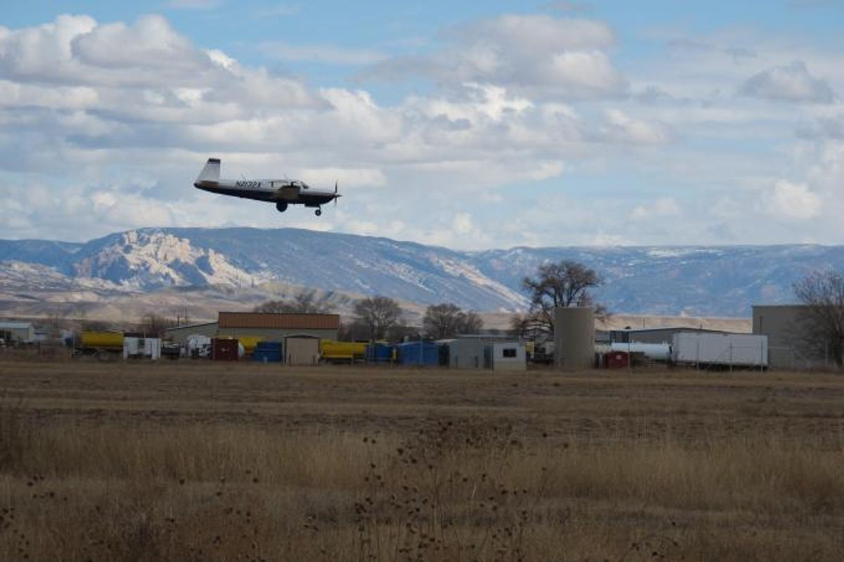 A research aircraft comes in for a landing in Vernal, Utah. Sensitive instruments aboard let CIRES and NOAA researchers measure atmospheric levels of methane and other chemicals during flights through Utah's Uintah. (Sonja Wolter/CIRES and NOAA)