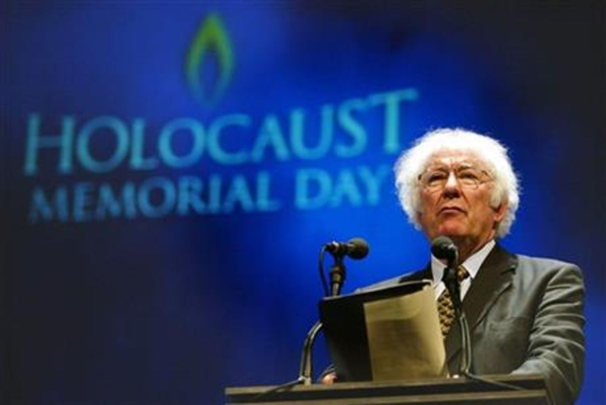 FILE - A Tuesday, Jan. 27, 2004 photo from files showing former Nobel Prize winning poet Seamus Heaney speaking during a rehearsal for the Northern Irish national Holocaust commemoration at the Waterfront Hall, Belfast, Northern Ireland.  (AP Photo/Peter Morrison, File)