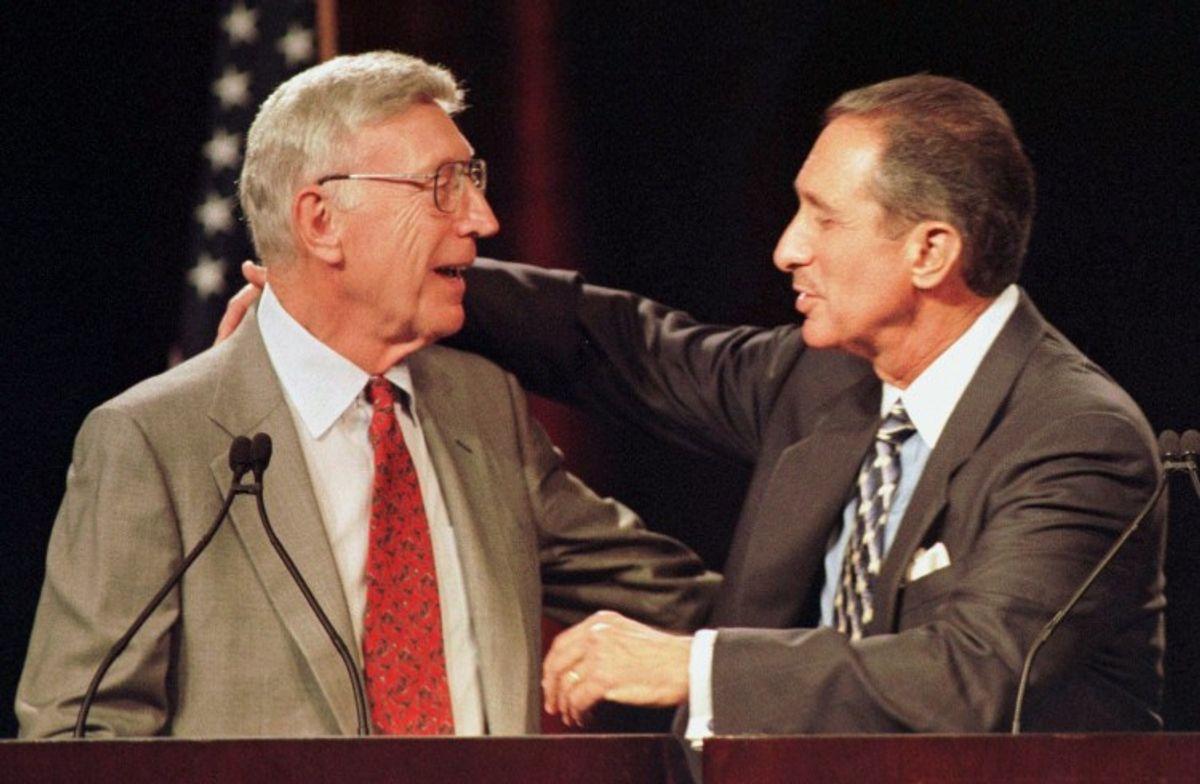 Home Depot Chairman Bernard Marcus, left, and Chief Executive Officer Arthur Blank hug each other on Wednesday, May 26, 1999. (Associated Press)