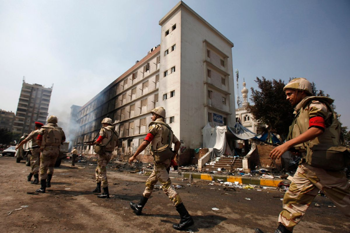 Egyptian soldiers move near a burnt annex building of Rabaa Adawiya mosque in Cairo, August 15, 2013.  (Reuters/Amr Dalsh)