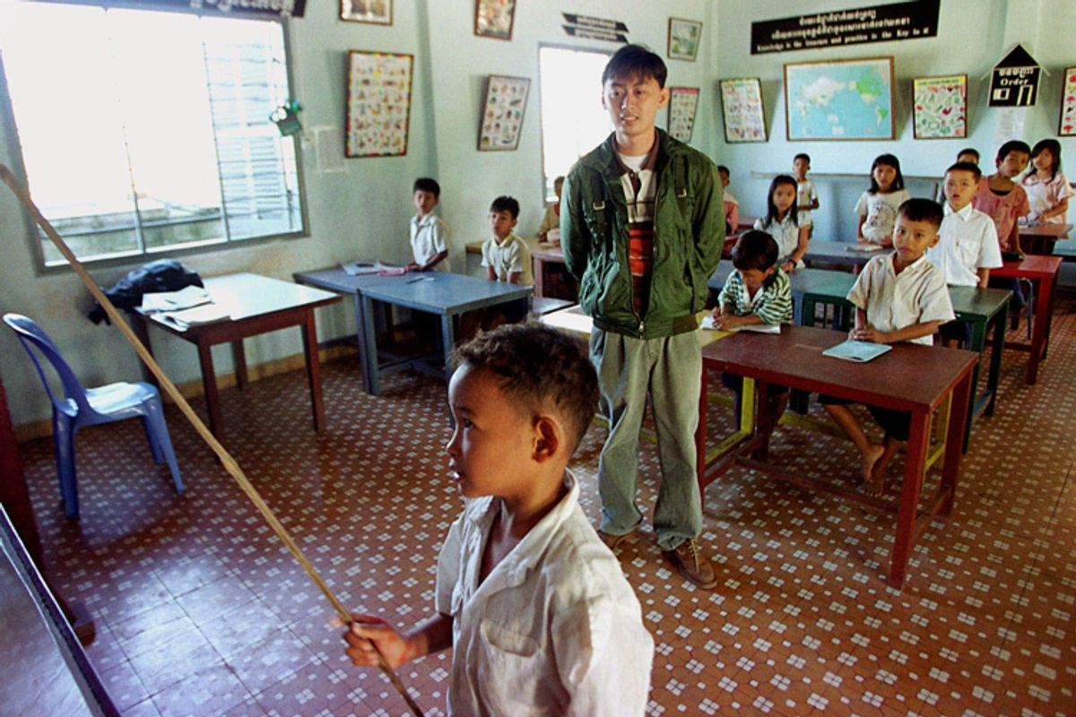 Cambodian orphans study English in a classroom at an orphanage on the outskirts of Phnom Penh Cambodia.    (AP/Andy Eames)