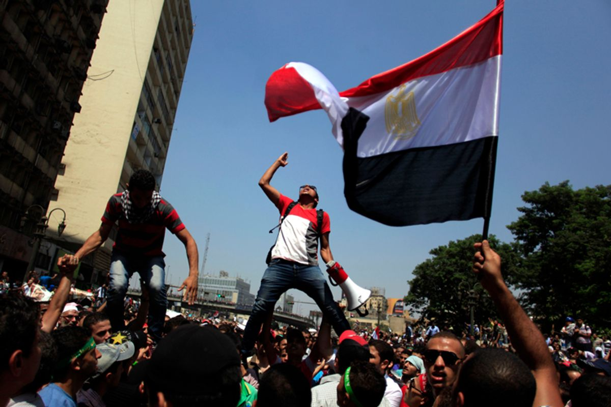 Supporters of Egypt's ousted President Mohammed Morsi chant slogans during a protest in Cairo, Aug. 16, 2013.     (AP/Khalil Hamra)
