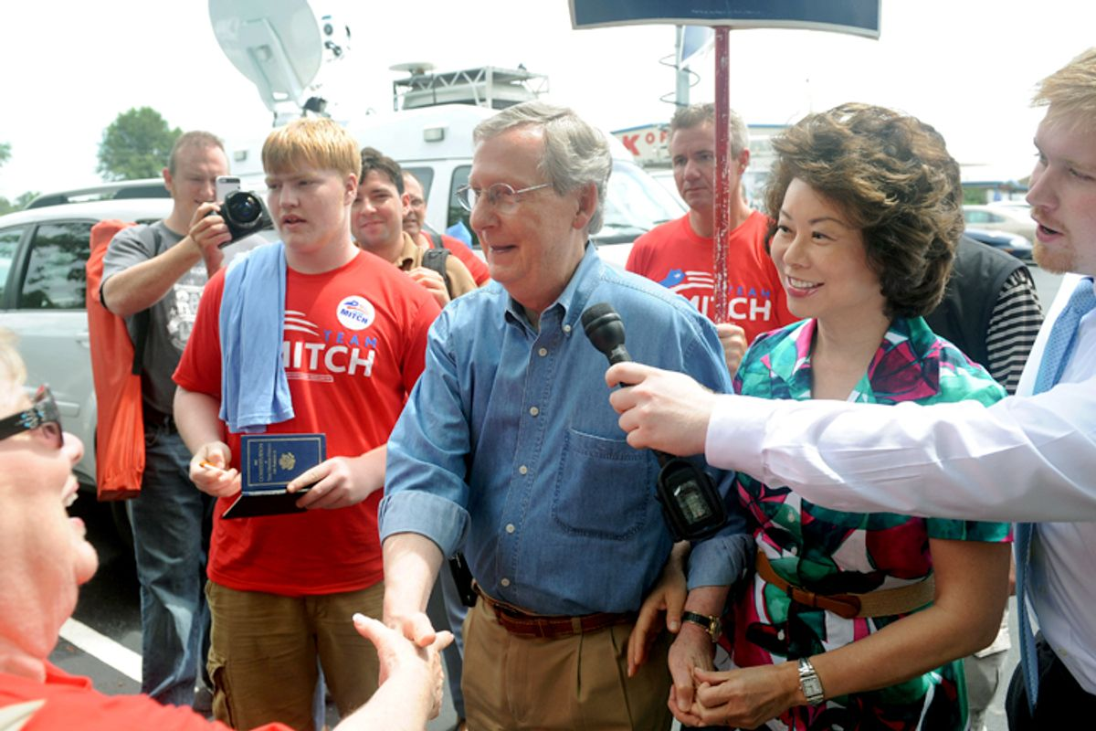 U.S. Sen. Mitch McConnell, R-KY, greets supporters during the 133rd Annual Fancy Farm Picnic in Fancy Farm, Ky., Saturday, Aug. 3, 2013.     (AP/Stephen Lance Dennee)