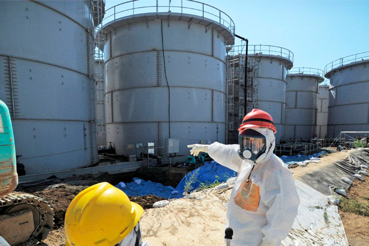 Japan's Economy, Trade and Industry Minister Toshimitsu Motegi (R), inspects contaminated water tanks          (Reuters/Kyodo Kyodo)