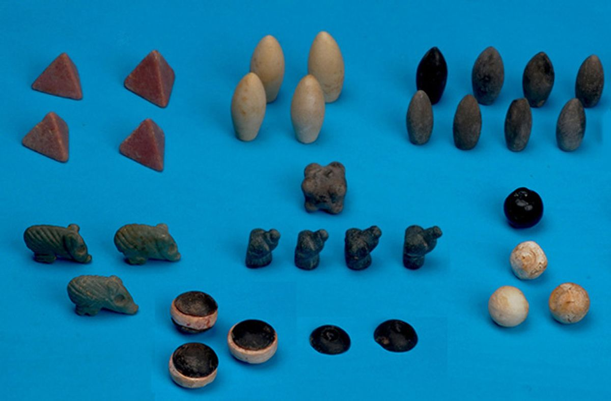 (The newly discovered ancient game board tokens (photo by Haluk Sağlamtimur, via Discovery News))