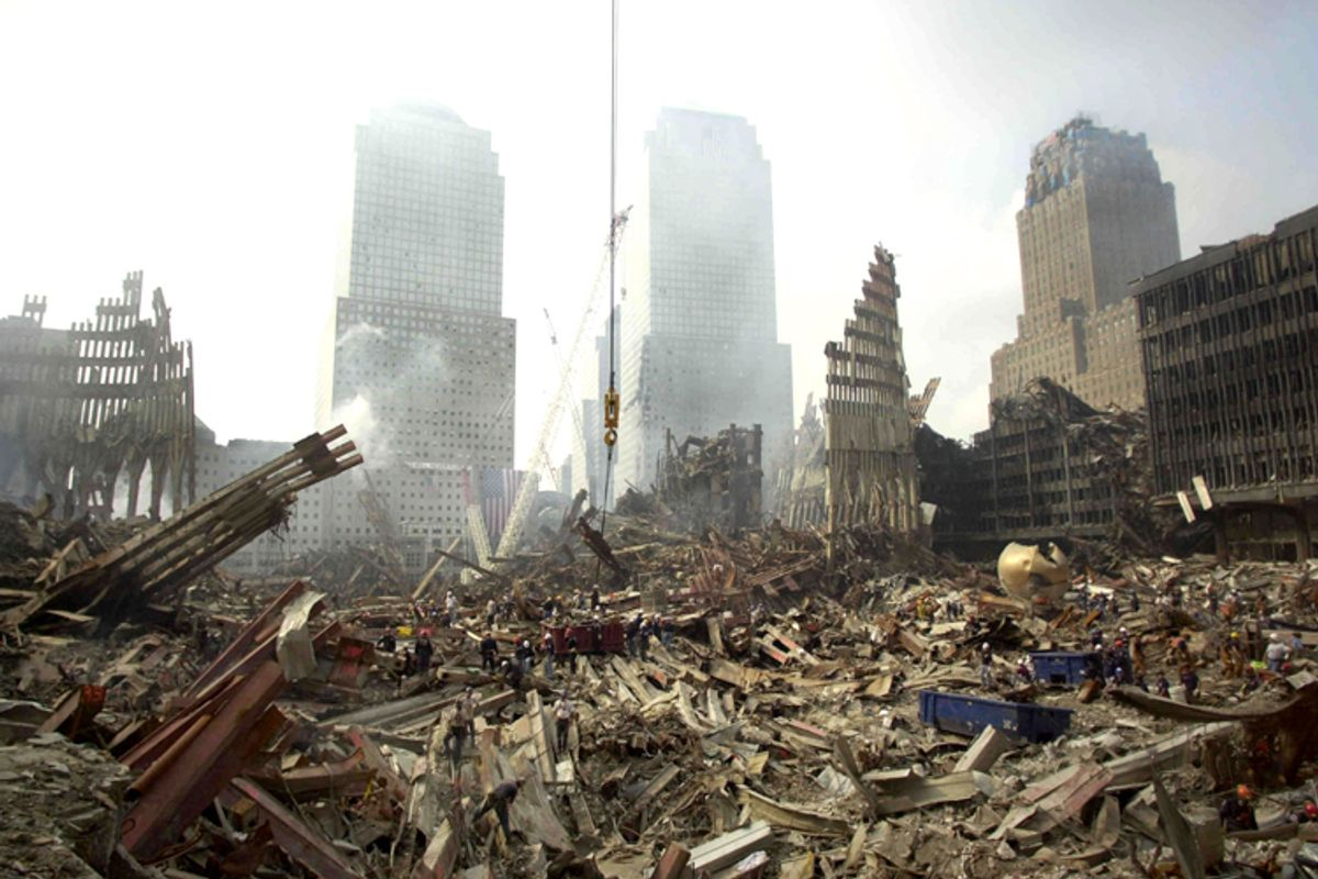 Rescue workers sift through debris at the scene of what was once the plaza area of the World Trade Center twin towers, Sept. 24, 2001.     (Reuters)