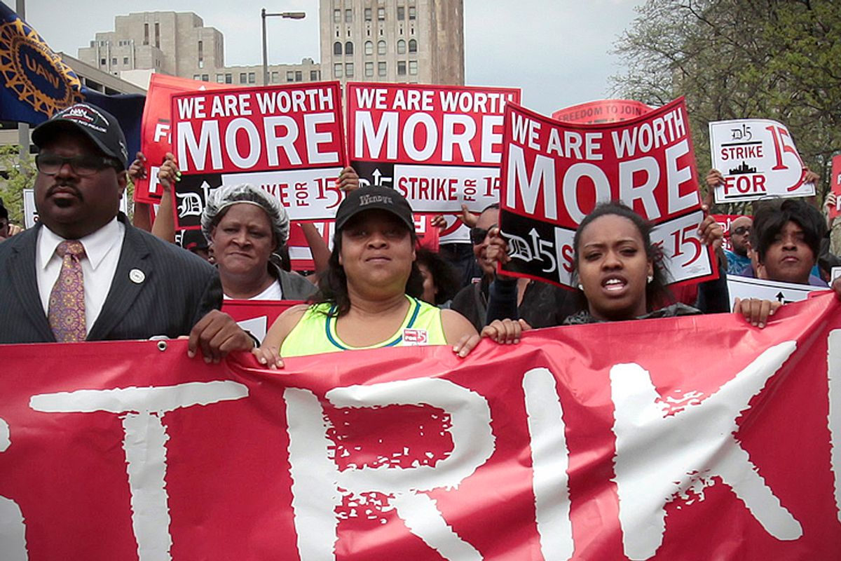 Workers and labor activists march for a higher minimum wage for fast food workers in Detroit, May 2013. (Reuters/Rebecca Cook)