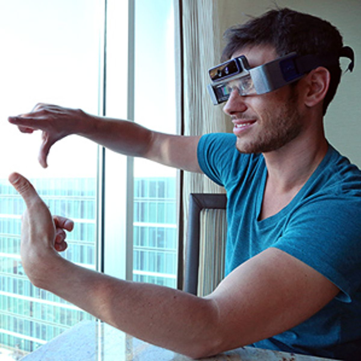 Eye spy: Meta founder Meron Gribetz tries out the first version of the startup's Space Glasses.  (Ray Lo)