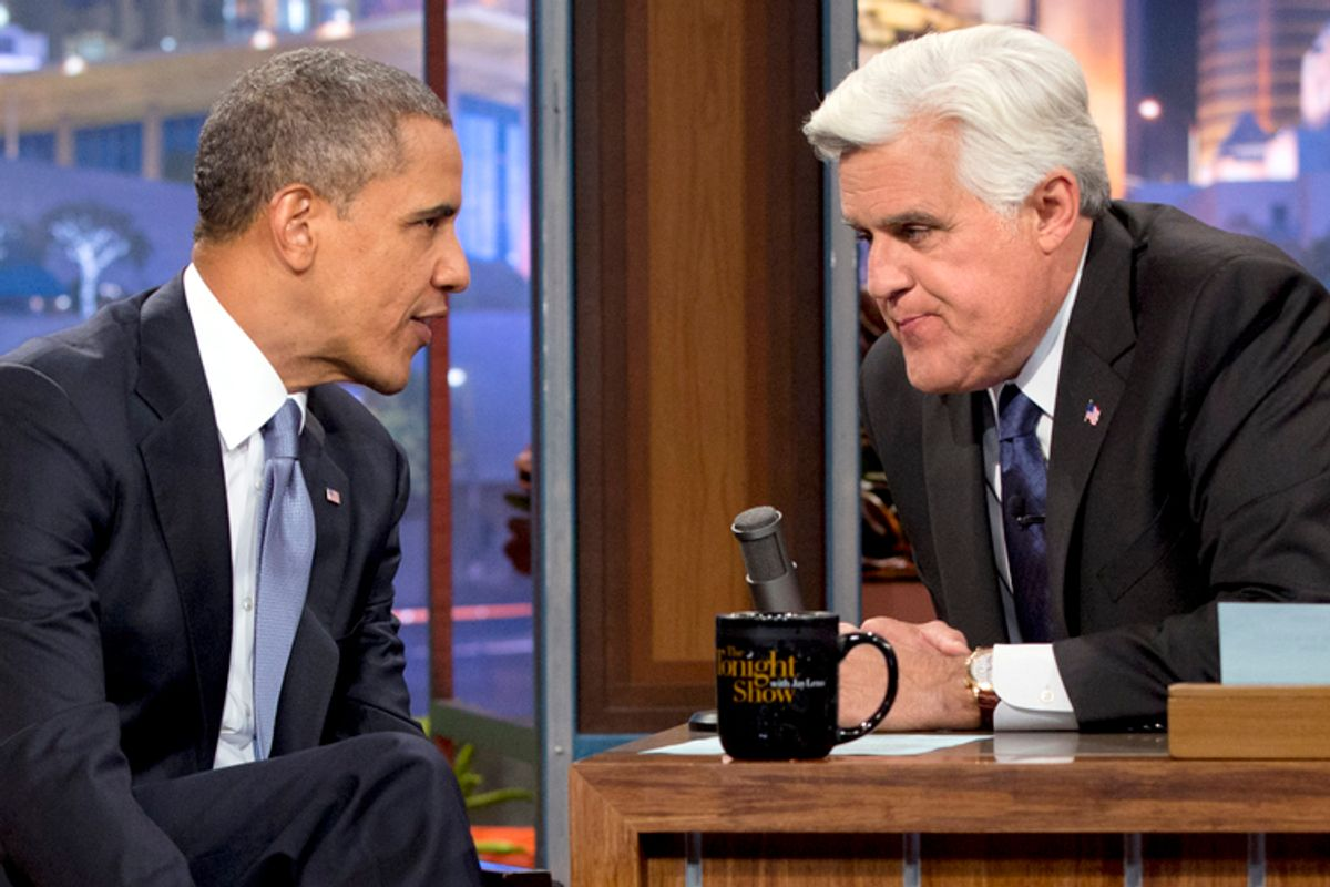 """Barack Obama talks with Jay Leno during the taping of his appearance on """"The Tonight Show with Jay Leno"""" on Aug. 6, 2013.              (AP/Jacquelyn Martin)"""