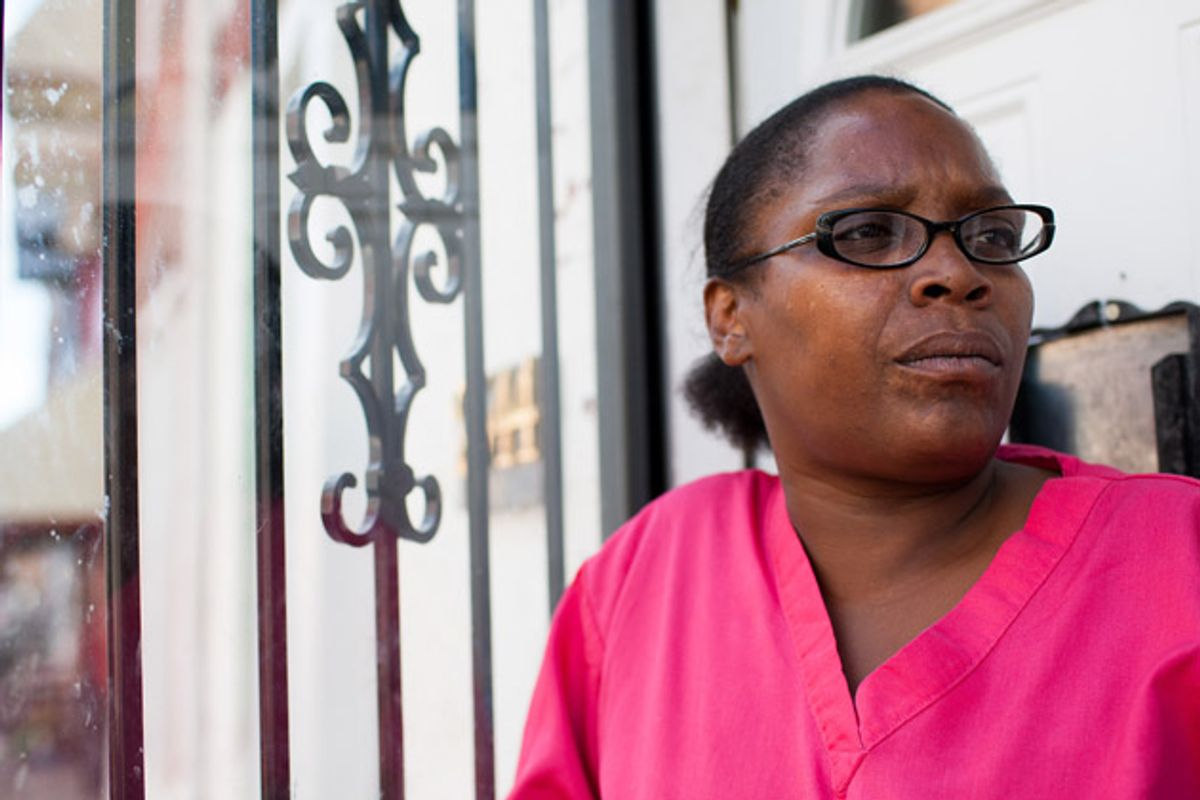 """Rochelle Bing outside of her row home in North Philadelphia. For two years, Bing fought the city to keep her house from being seized under """"civil forfeiture"""" laws.  (Andrew Renneisen for ProPublica)"""