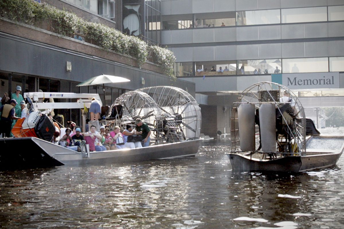 An airboat pulls up to the Memorial Medical Center in New Orleans on Wednesday, Aug. 31, 2005.       (AP/Bill Haber)