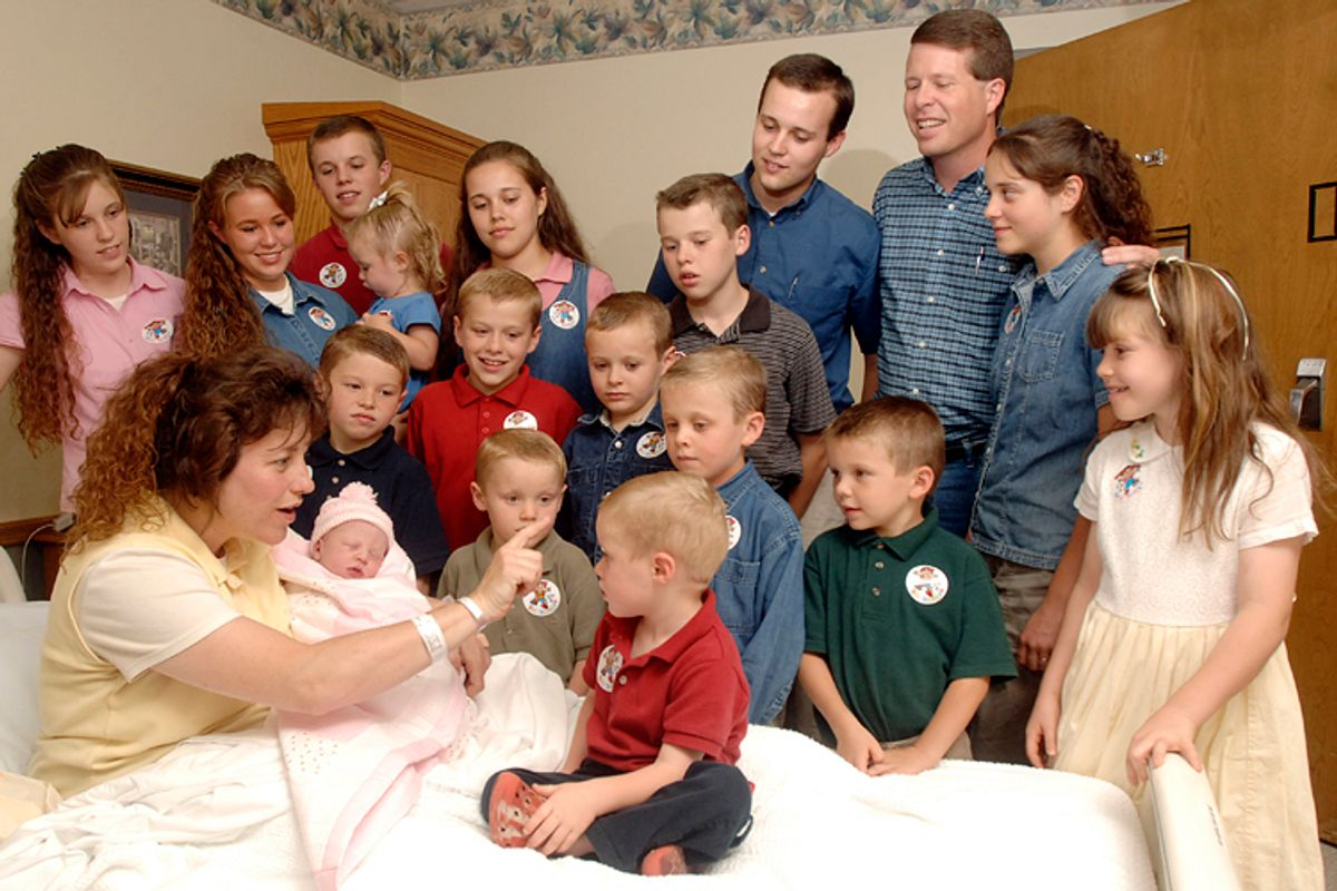 In this Aug. 2, 2007 photo, Michelle Duggar is surrounded by her then only 17 children, and husband Jim Bob.                             (AP/Beth Hall)