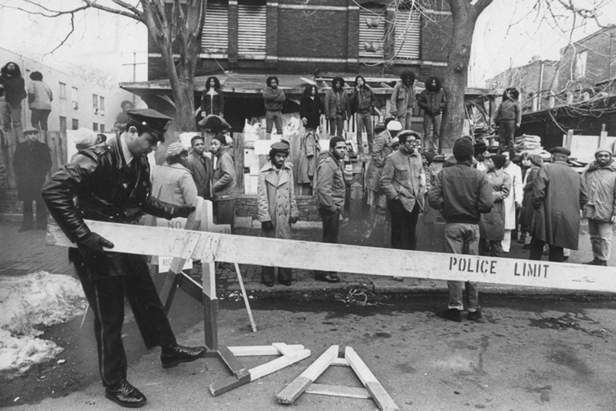 """MOVE members and police during the 1978 confrontation outside MOVE headquarters, in a still from """"Let the Fire Burn.""""     (Zeitgeist Films)"""