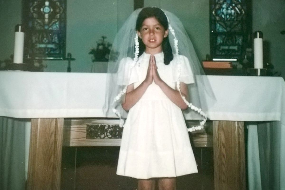A photo of the author at her First Communion