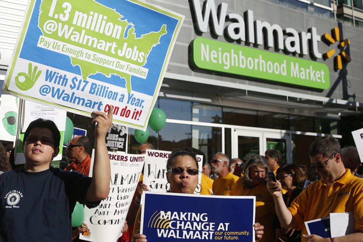 Protesters gather outside a Wal-Mart Neighborhood Store for a peaceful demonstration Thursday, Sept. 5, 2013, in Chicago.                                   (AP/Charles Rex Arbogast)