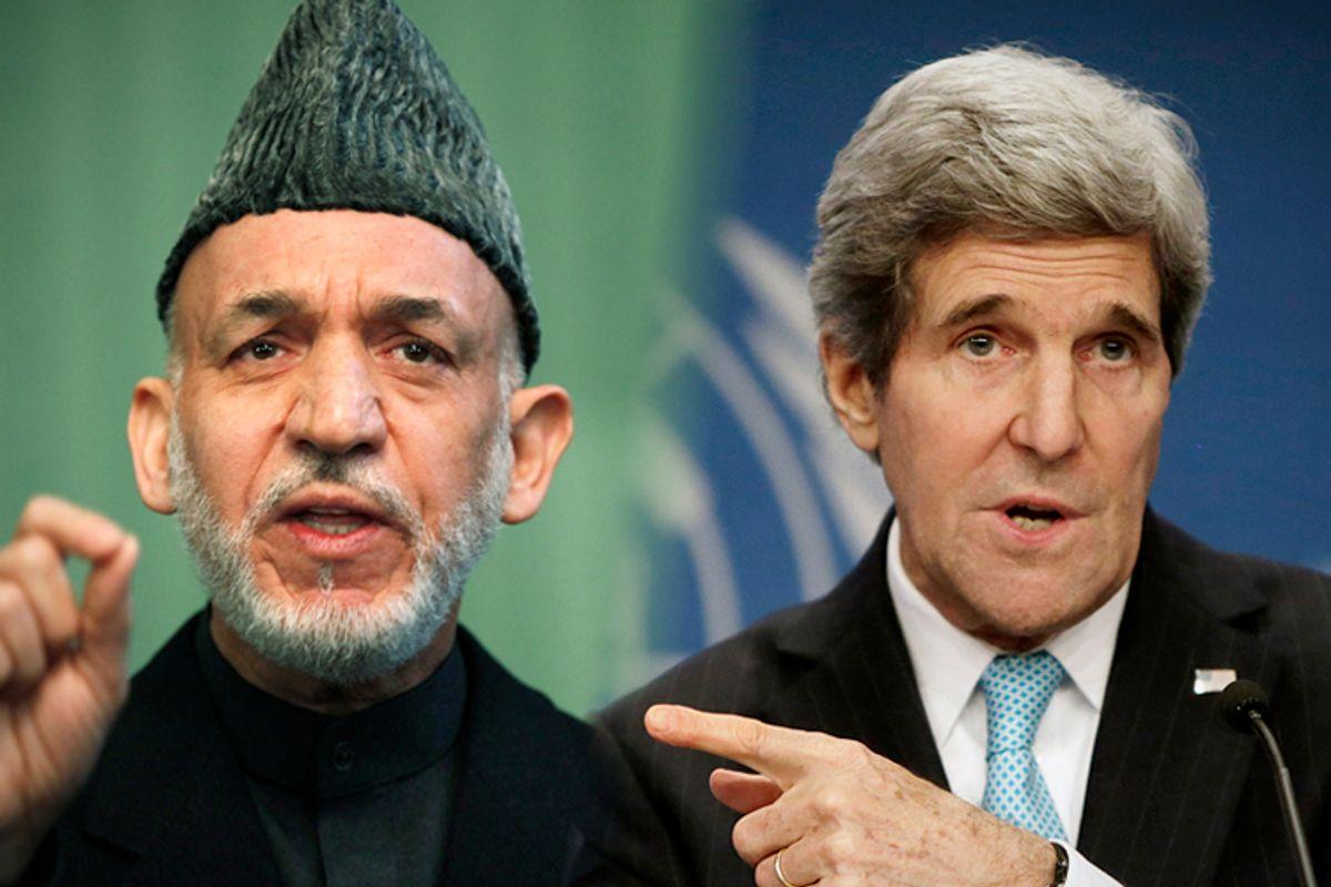 Hamid Karzai, John Kerry         (Reuters/Mohammad Ismail/Gary Cameron)