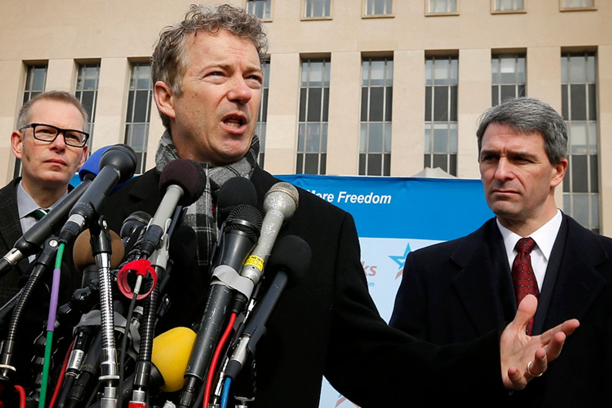 Rand Paul, center, Ken Cuccinelli, right.     (AP/Charles Dharapak)