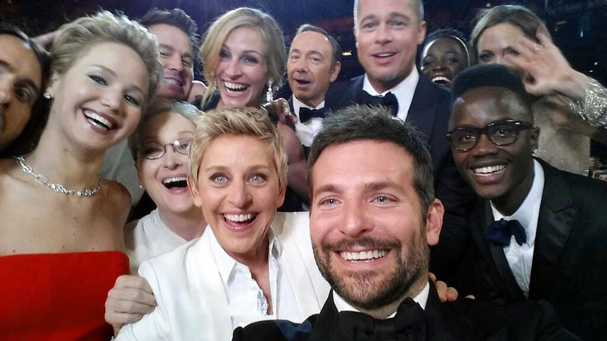 """This image released by Ellen DeGeneres shows actors, front row from left, Jared Leto, Jennifer Lawrence, Meryl Streep, Ellen DeGeneres, Bradley Cooper, Peter Nyong'o Jr. and, second row, from left, Channing Tatum, Julia Roberts, Kevin Spacey, Brad Pitt, Lupita Nyong'o and Angelina Jolie as they pose for a """"selfie"""" portrait on a cell phone during the Oscars at the Dolby Theatre on Sunday, March 2, 2014, in Los Angeles. (AP Photo/Ellen DeGeneres) (AP)"""