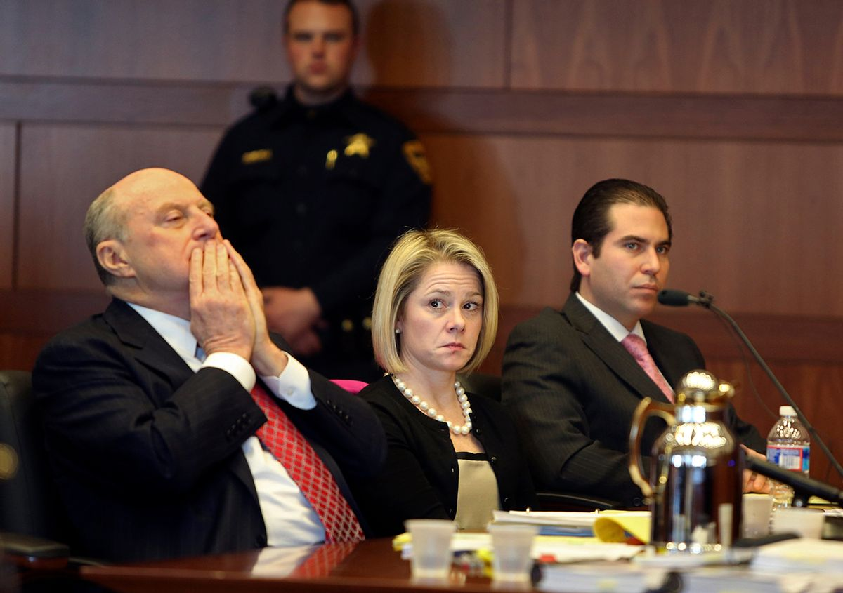 New Jersey Gov. Chris Christie's former Deputy Chief of Staff Bridget Anne Kelly, center, sits with her attorney Michael Critchley, left, and defense team member attorney Edmund DeNoia, right,  during a hearing Tuesday, March 11, 2014, in Trenton, N.J. Attorneys for Kelly and former Christie campaign manager Bill Stepien were in court to try to persuade a judge not to force them to turn over text messages and other private communications to New Jersey legislators investigating the political payback scandal ensnaring Christie's administration. (AP Photo/The Record of Bergen County, Chris Pedota, Pool) (AP)
