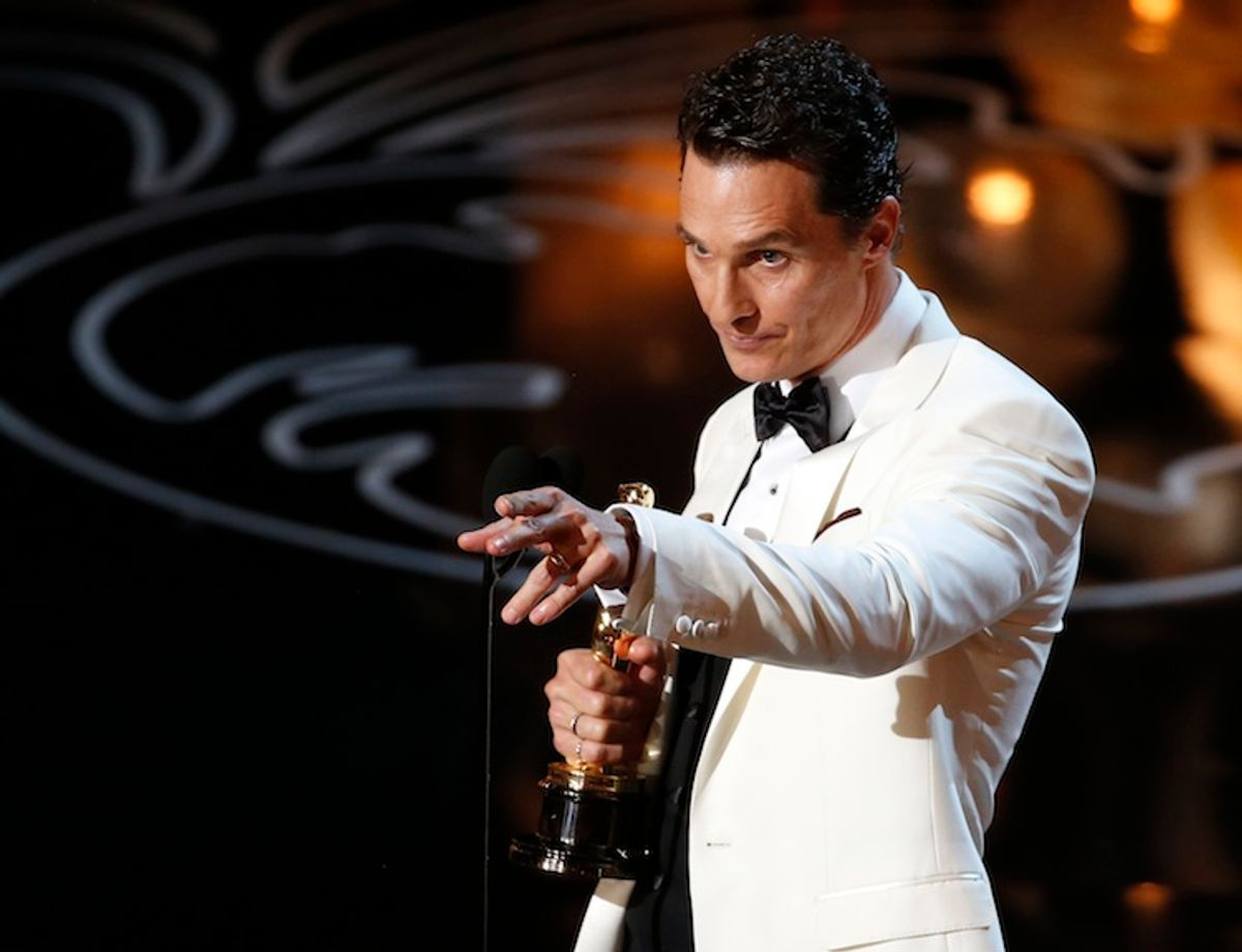"""Matthew McConaughey accepts the Oscar for best actor for his role in """"Dallas Buyers Club"""" at the 86th Academy Awards in Hollywood, California March 2, 2014.        (REUTERS/Lucy Nicholson)"""