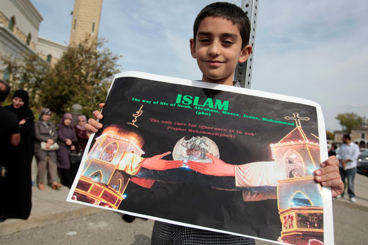 Muslim-American Ali-Jaafar Al-Zain, 9, holds a poster during a peaceful interfaith rally in Dearborn, Michigan September 21, 2012.       (Reuters/Rebecca Cook)
