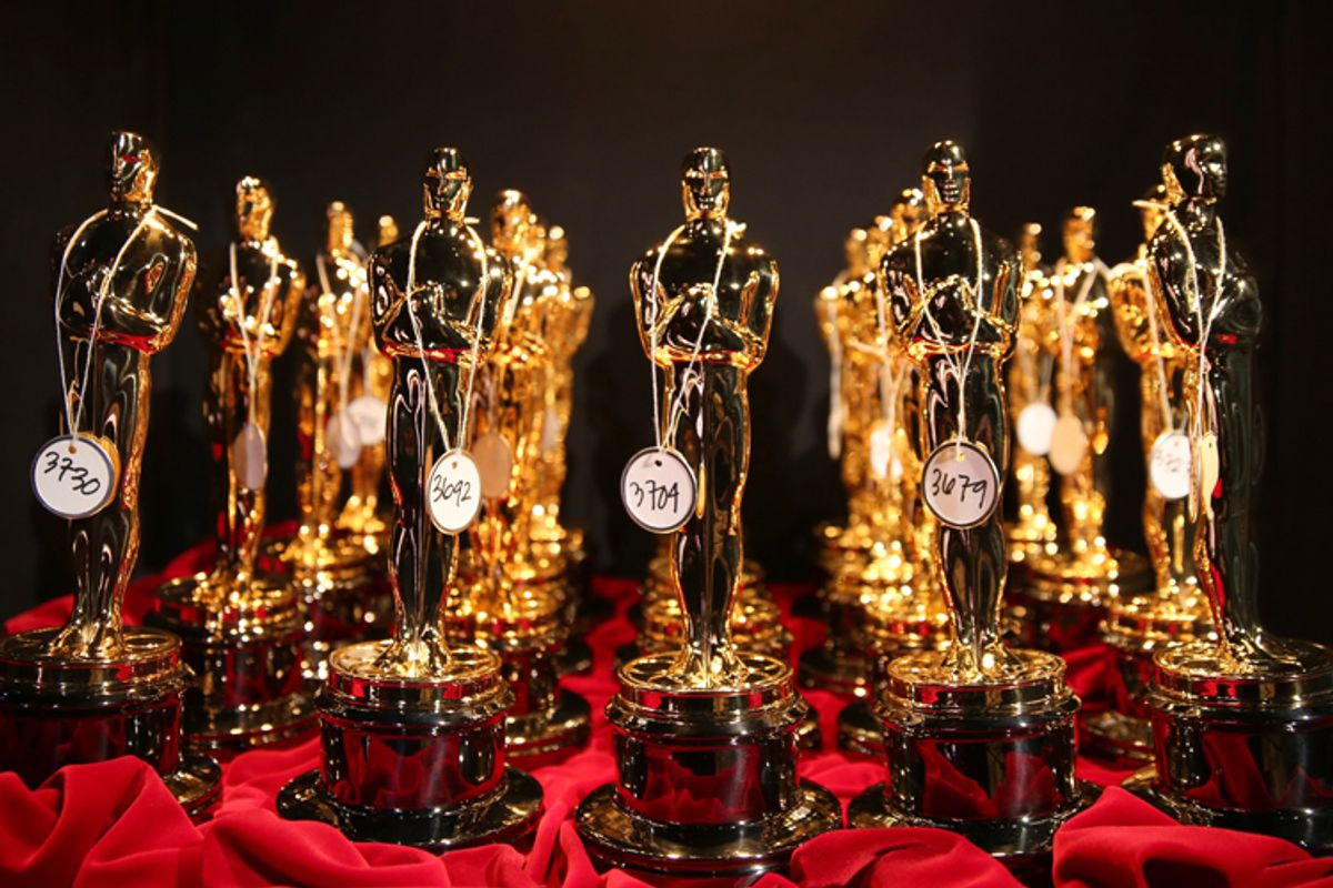 Oscar statues are lined up backstage during the Oscars at the Dolby Theatre, March 2, 2014.           (AP/Matt Sayles)