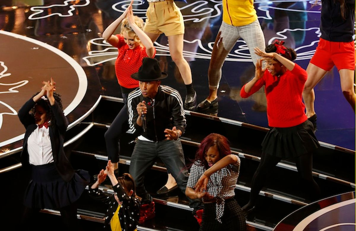 Singer Pharrell Williams (C) performs at the 86th Academy Awards in Hollywood, California March 2, 2014.     (REUTERS/Lucy Nicholson)