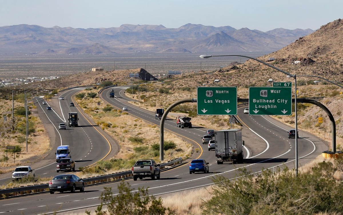 """In this Friday, Nov. 8, 2013 photo, motorists head northbound toward Las Vegas on U.S. Highway 93, near Kingman, Ariz. Supporters of proposals to build an interstate highway connecting Phoenix and Las Vegas say an interstate would create a Los Angeles-Phoenix-Las Vegas """"megaregion"""" and open a trade route from Mexico to Pacific Ocean ports and Canada. (AP Photo/Julie Jacobson) (AP)"""