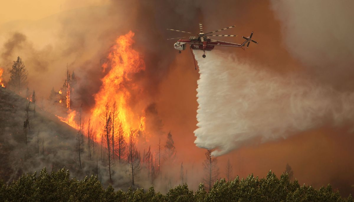 This Aug. 16, 2013 file photo shows helicopters battling the 64,000 acre Beaver Creek Fire north of Hailey, Idaho. (AP Photo/Times-News, Ashley Smith, File)