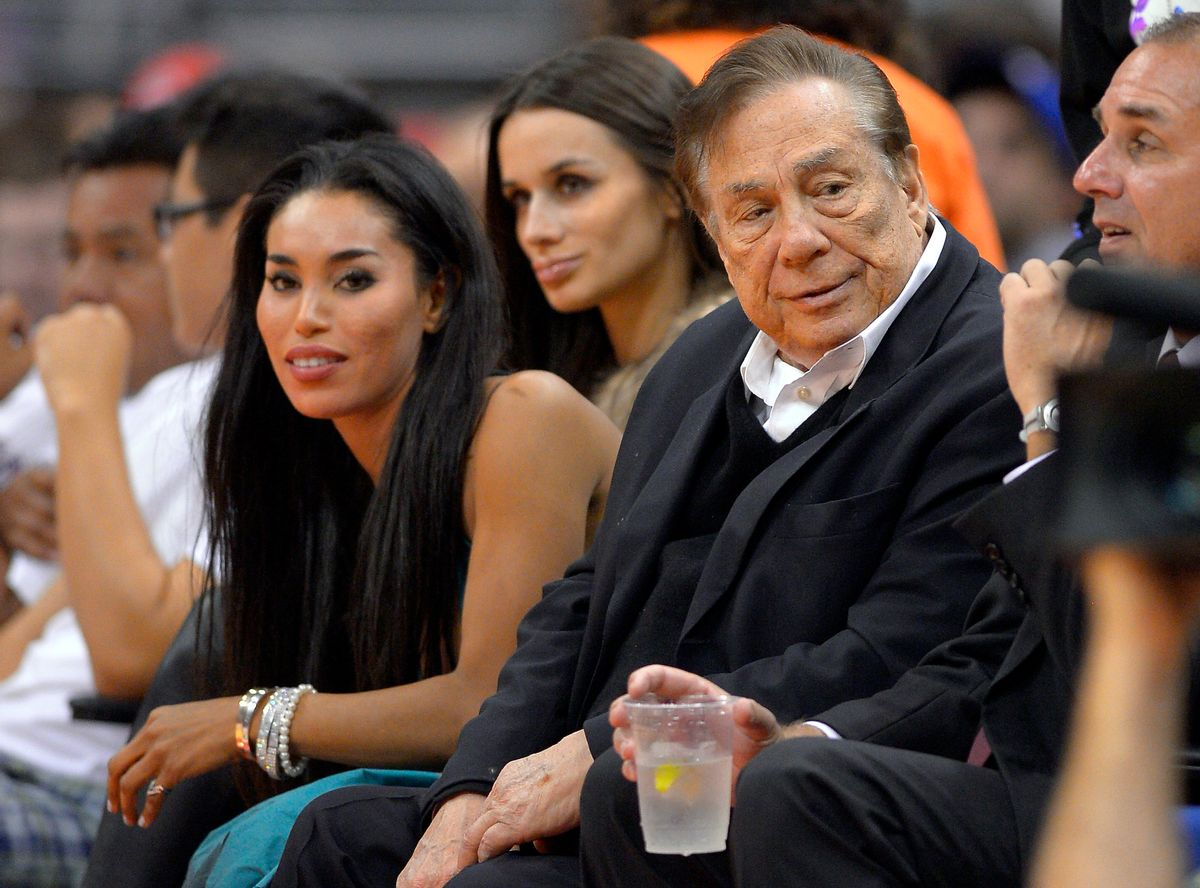 Los Angeles Clippers owner Donald Sterling and V. Stiviano          (Associated Press)