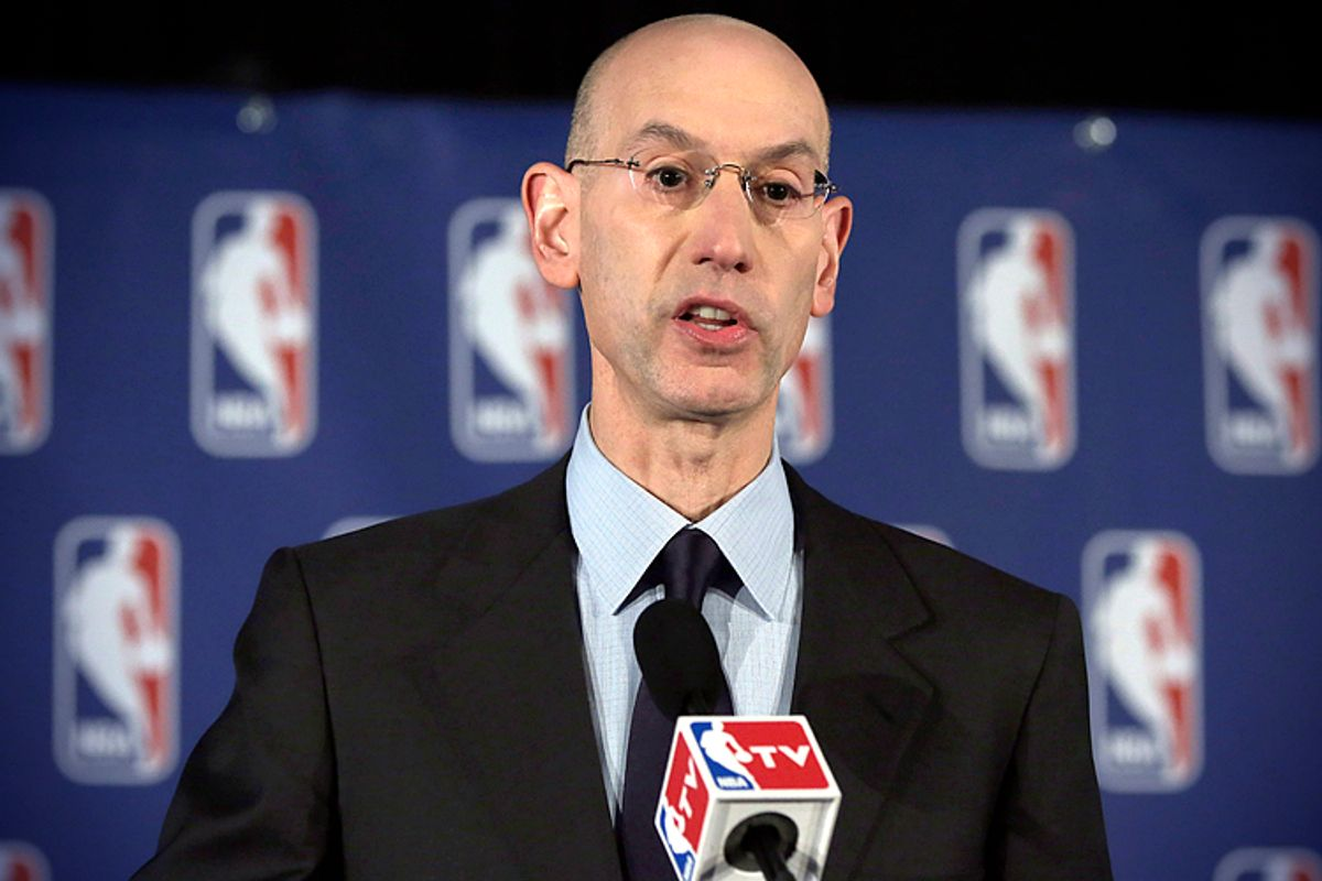Adam Silver reads a statement during a news conference, in New York, April 29, 2014, announcing that he is banning Los Angeles Clipper owner Donald Sterling for life from the Clippers organization.     (AP/Richard Drew)