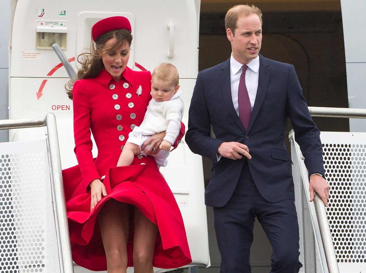Britain's Prince William and his wife Kate, the Duchess of Cambridge with Prince George arrive for their visit to New Zealand at the International Airport, in Wellington, New Zealand, Monday, April 7, 2014. (AP Photo/SNPA, David Rowland) NEW ZEALAND OUT (AP)