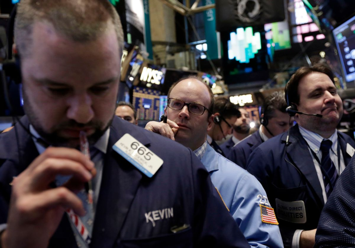 Traders work on the floor of the New York Stock Exchange, Friday, April 11, 2014. Weaker earnings at JPMorgan Chase are dragging bank stocks lower in early trading. Technology and biotech stocks also fell, a day after the worst rout for the Nasdaq composite index since 2011. (AP Photo/Richard Drew) (AP)