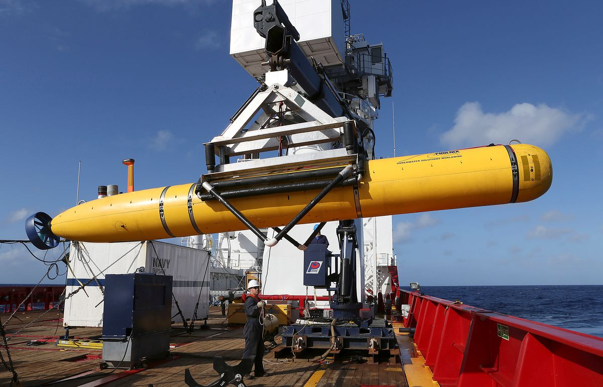 In this Thursday, April 17, 2014 photo provided by the Australian Defence Force the Phoenix International Autonomous Underwater Vehicle (AUV) Artemis is craned over the side of Australian Defence Vessel Ocean Shield before launching the vehicle in to the southern Indian Ocean in the search of the missing Malaysia Airlines Flight 370Malaysia Airlines MH370. Up to 11 aircraft and 12 ships continue to scan the ocean surface for debris from the Boeing 777 that disappeared March 8 en route from Kuala Lumpur to Beijing with 239 people on board. (AP Photo/Australian Defence Force, Bradley Darvill) EDITORIAL USE ONLY    (Lsis Bradley Darvill)