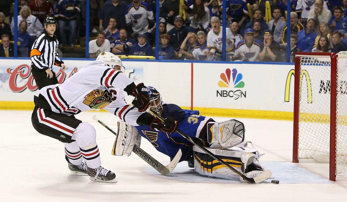 Chicago Blackhawks center Jonathan Toews (left) scores the game-winning goal in overtime past St. Louis Blues goaltender Ryan Miller during Game 5 of a Western Conference quarterfinal playoff game Friday, April 25, 2014, at the Scottrade Center in St. Louis. (AP Photo/The St. Louis Post-Dispatch, Chris Lee) (AP)
