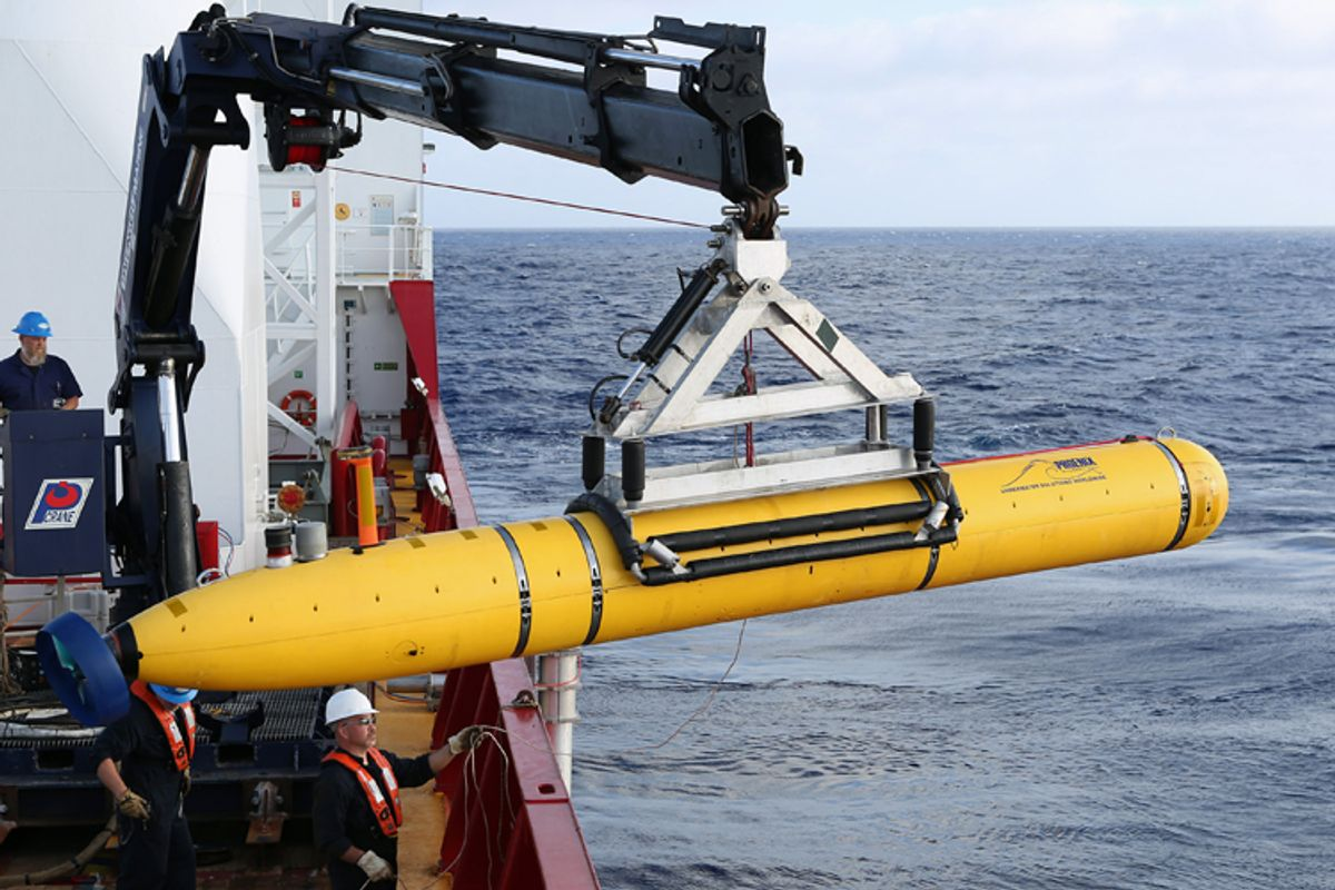 Crew move the U.S. Navy's Bluefin-21 autonomous underwater vehicle into position for deployment in the southern Indian Ocean, April 14, 2014.       (Reuters/Peter D. Blair)