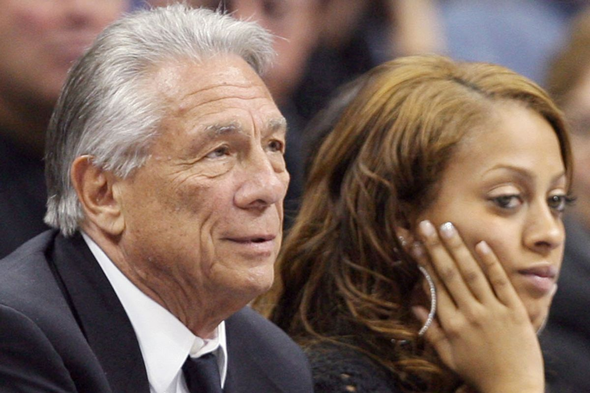 Donald Sterling watches his team beat the Denver Nuggets in Denver on April 29, 2006. LaLa Vasquez, right,  fiancee of Nuggets forward Carmelo Anthony, reacts as time runs out in the game.                 (AP/David Zalubowski)