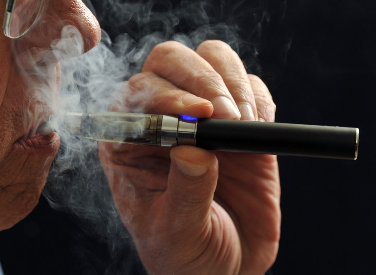 In this Jan. 17, 2014 photo, a smoker demonstrates an e-cigarette in Wichita Falls, Texas. ((AP Photo/Wichita Falls Times Record News, Torin Halsey))