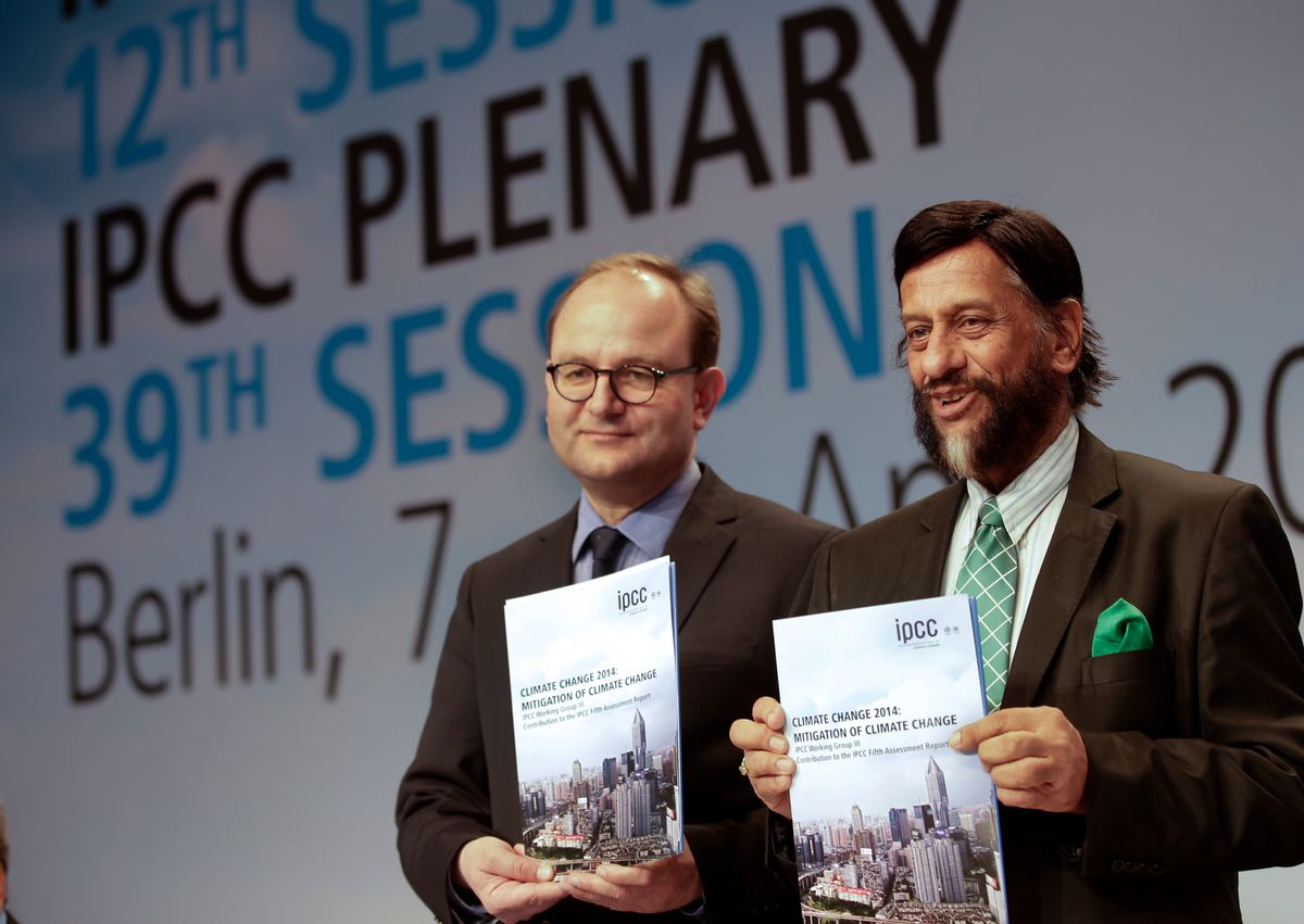 Ottmar Edenhofer, Co-Chairman of the IPCC Working Group III, and Rejendra K. Pachauri, Chairman of the IPCC, from left, pose prior to a press conference as part of a meeting of the Intergovernmental Panel on Climate Change (IPCC) in Berlin, Germany, Sunday, April 13, 2014.   (AP/Michael Sohn)