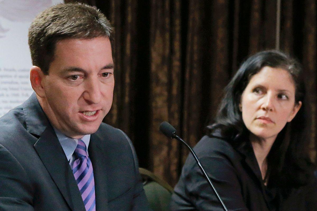 Glenn Greenwald, Laura Poitras            (Reuters/Eduardo Munoz)
