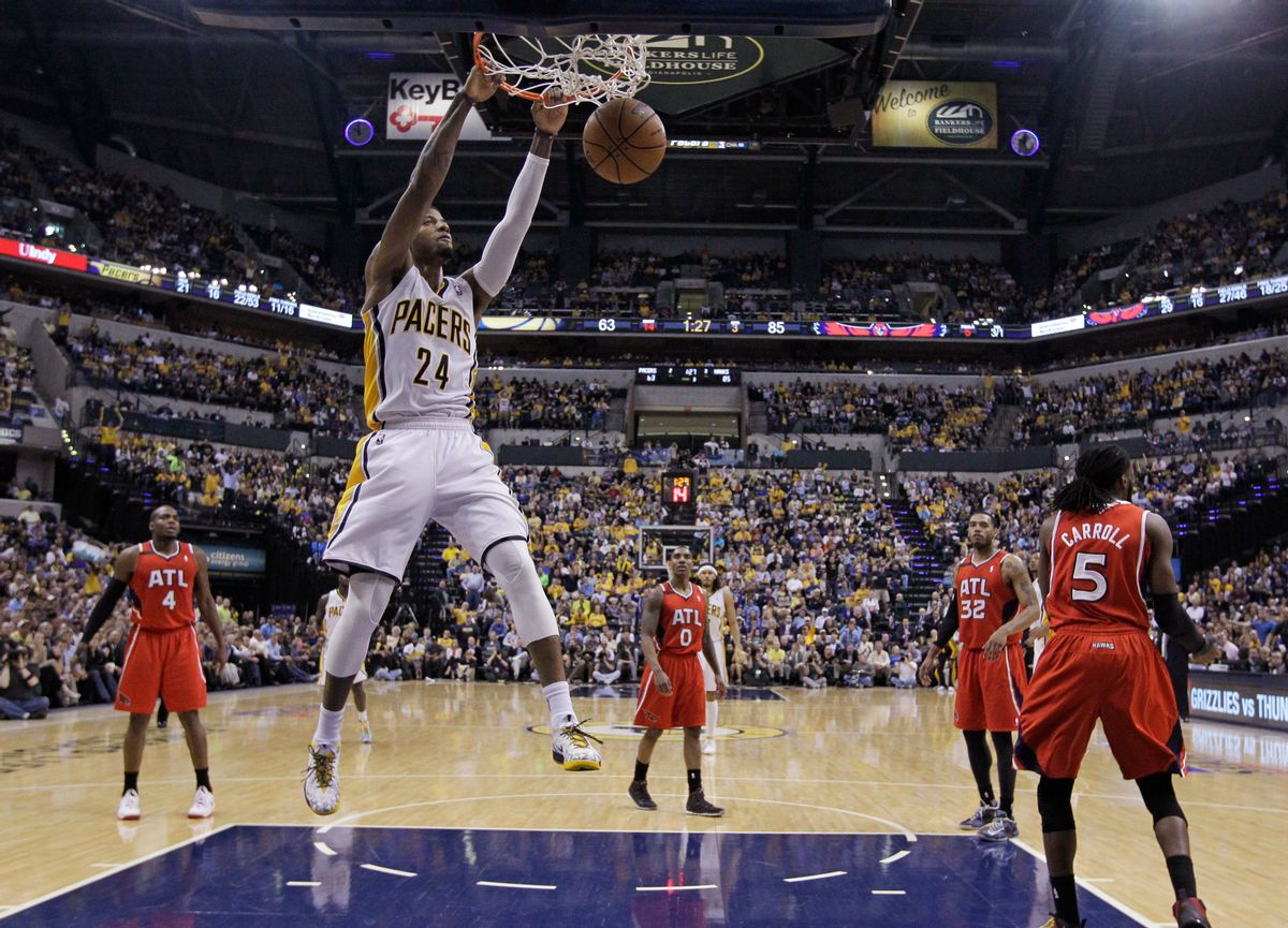 Indiana Pacers' Paul George (24) dunks during the second half in Game 5 of an opening-round NBA basketball playoff series against the Atlanta Hawks Monday, April 28, 2014, in Indianapolis. Atlanta defeated Indiana 107-97. (AP Photo/Darron Cummings) (AP)