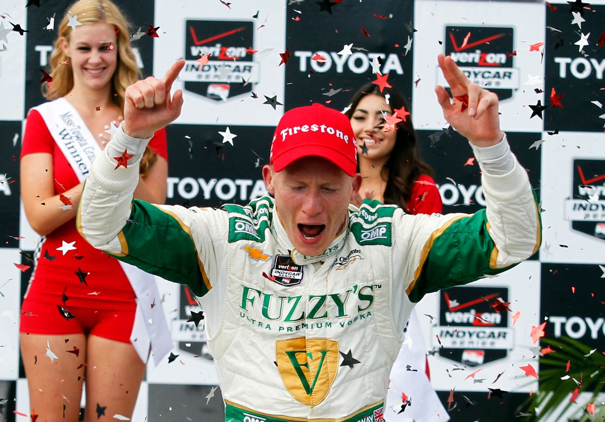 Mike Conway, of England, celebrates his win in the IndyCar Grand Prix of Long Beach auto race, Sunday, April 13, 2014, in Long Beach, Calif. (AP Photo/Alex Gallardo) (AP)