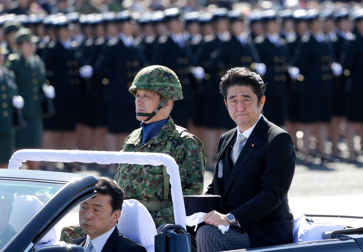 FILE - In this Sunday, Oct. 27, 2013 file photo, Japanese Prime Minister Shinzo Abe, right, reviews members of Japan Self-Defense Forces (SDF) during the Self-Defense Forces Day at Asaka Base, north of Tokyo. Japan relaxed a decades-old ban on military-related exports Tuesday, April 1, 2014, in a bid to expand joint arms development with allies and equipment sales to Southeast Asia and elsewhere. The new guidelines endorsed Tuesday by the Cabinet are part of Abe's push to bolster national security amid China's military expansion and North Korea's nuclear threat. (AP Photo/Shizuo Kambayashi, File) (AP)