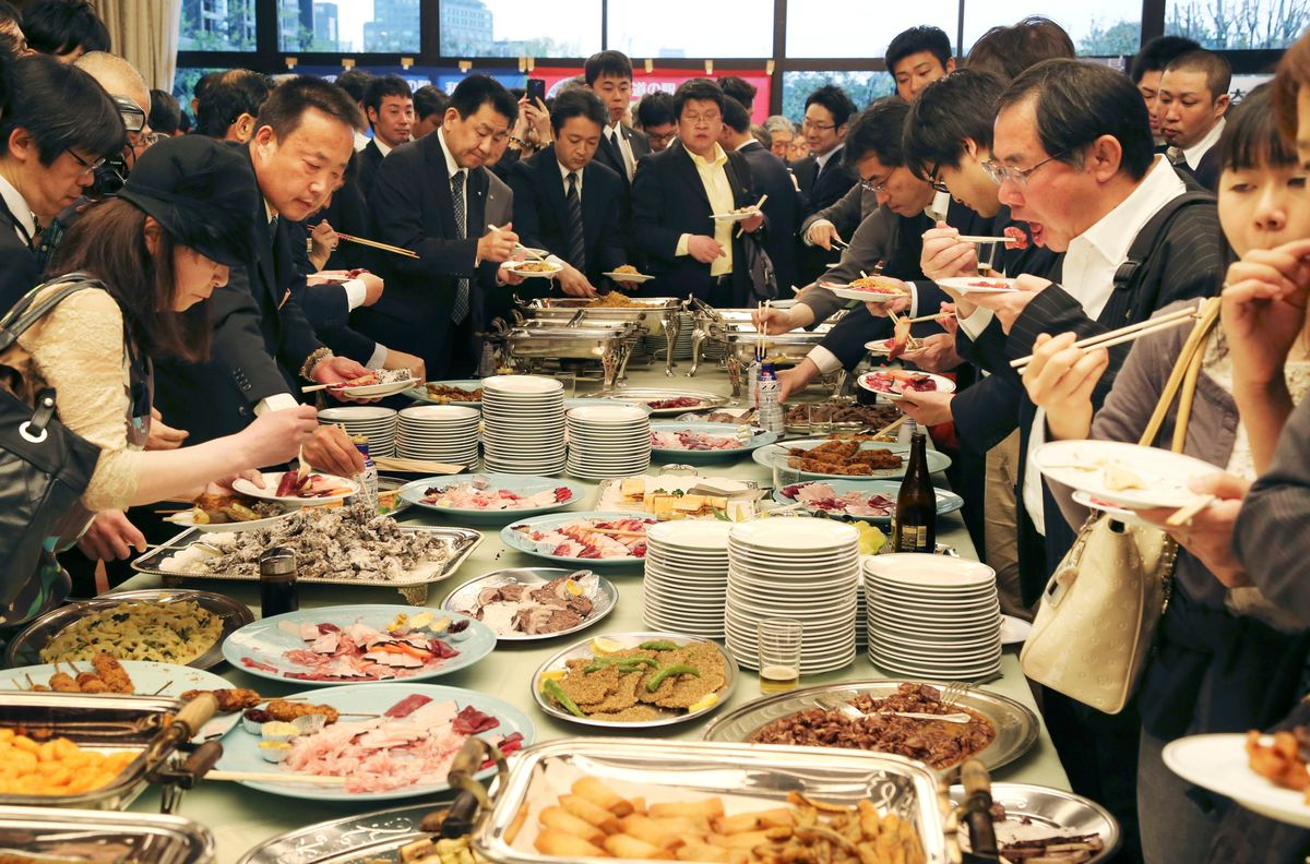 Supporters of whaling eat meat of whale during a meeting of the 26th support whaling event in Tokyo, Tuesday, April 15, 2014. (AP Photo/Koji Sasahara)  (Koji Sasahara)