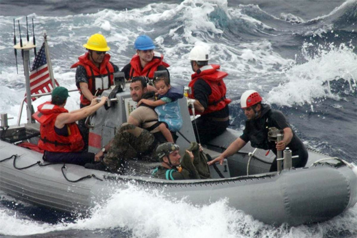 The U.S. Coast Guard assists in the rescue of the Kaufman family, Sunday, April 6, 2014.     (AP)