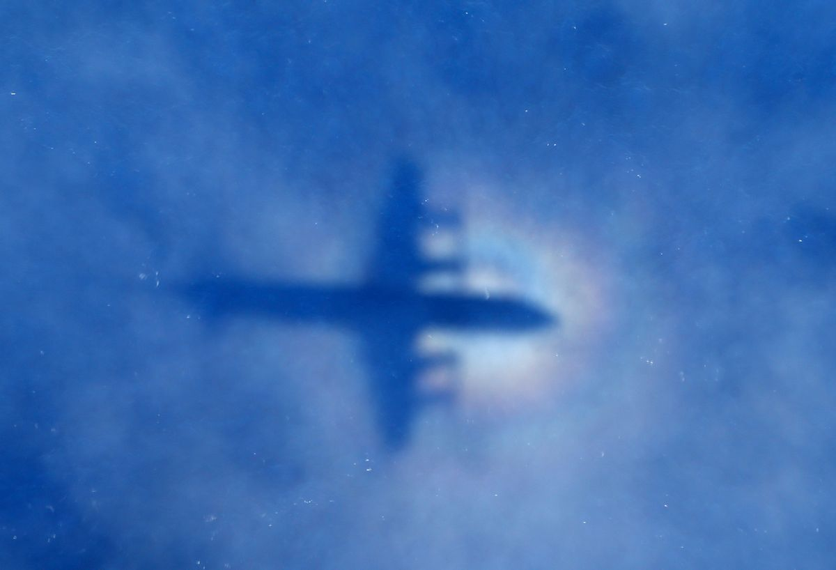 In this March 31, 2014 photo, a shadow of a Royal New Zealand Air Force P-3 Orion aircraft is seen on low cloud cover while it searches for missing Malaysia Airlines Flight MH370 in the southern Indian Ocean.  ((AP Photo/Rob Griffith))