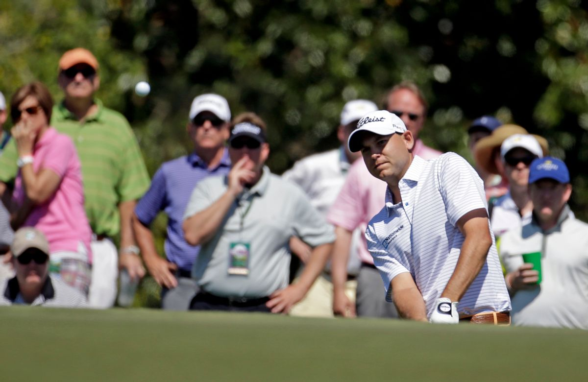 Bill Haas watches his chip shot to the 17th green during the first round of the Masters golf tournament Thursday, April 10, 2014, in Augusta, Ga. (AP Photo/Darron Cummings) (Darron Cummings)