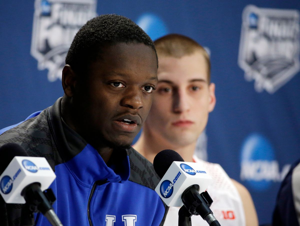 Kentucky's Julius Randle, left, and Wisconsin's Ben Brust participate in a news conference for their NCAA Final Four tournament college basketball semifinal game Thursday, April 3, 2014, in Dallas.  (AP/David J. Phillip)