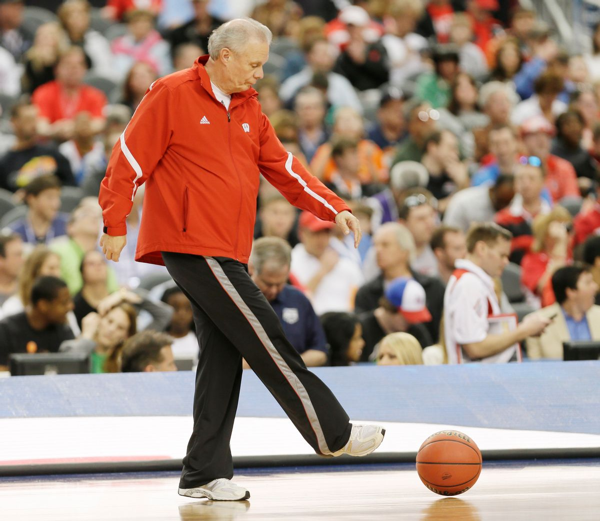 Wisconsin head coach Bo Ryan clears a ball from the floor during practice for an NCAA Final Four tournament college basketball semifinal game Friday, April 4, 2014, in Dallas. Wisconsin plays Kentucky on Saturday, April 5, 2014. (AP Photo/Charlie Neibergall) (Charlie Neibergall)