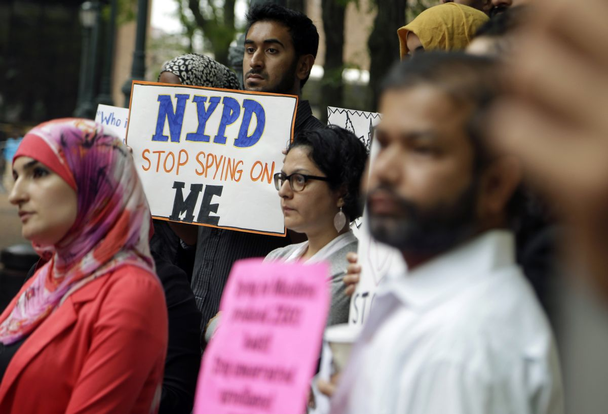 FILE - In this Aug. 28, 2014, file photo, a group of people hold signs protesting the New York Police Department's program of infiltrating and informing on Muslim communities during a rally near police headquarters in New York. On Tuesday, April 15, 2014, the NYPD confirmed it disbanded the special intelligence unit that monitored Muslim communities in New York and New Jersey. (AP Photo/Seth Wenig, File)     (AP)